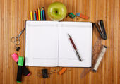 School supplies on a wooden table — ストック写真