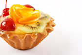 Sweet cake with fruits on white background — Stock Photo