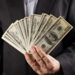 Businessman holds money in hands — Stock Photo