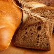 Bread on wood table — Stock Photo