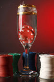 Poker chips in the glass of water. — Stock fotografie