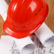 hardhat on blueprint — Stock Photo