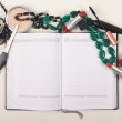 Various Cosmetics on opened notebook — Stock Photo