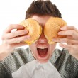 Foto Stock: Man eating hamburger
