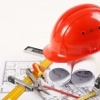 Hardhat on blueprint — Stock Photo #24425763