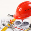 Stock Photo: Hardhat on blueprint
