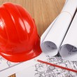Hardhat on blueprint — Stock Photo #24425971