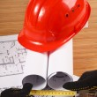 Hardhat on blueprint — Stock Photo #24425973