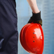 Construction hard hat in hand — Stock Photo