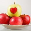 Red and green apples with heart — Stock Photo