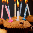 Tasty chocolate muffins with candle — Stock Photo