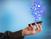 Mobile phone in hand businessman and Icons — Stock Photo
