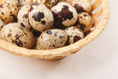 Quail eggs in the basket — Stock Photo