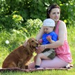 Mother, child and dog on picnic — Stock Photo