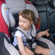 Stock Photo: Baby girl safely sitting in his car sea
