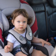 The baby girl safely sitting in his car sea — Stock Photo #25683089