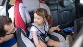 The baby girl safely sitting in his car sea — Stock Photo