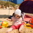 Baby girl playing with plastic toys o the beach — Stock Photo #25767117