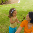 Mother with baby girl play in park — Stock Photo