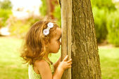 The baby girl plays in park — Stock Photo