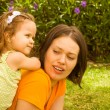 Stock Photo: Mother with baby girl play in park