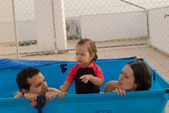 The happy family play in pool — Foto Stock