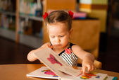 Baby girl reading book — Stock Photo