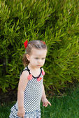 The baby girl walking alone in park — Stock Photo