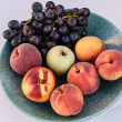 Stock Photo: Varies of fruits in vase