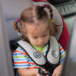 Toddler girl sitting in a child car seat  — Stock Photo