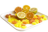 Oranges fruits and candies — Stock Photo