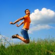 Happy young woman jumping — Stock Photo #1017175