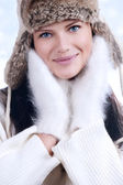 Beautiful woman in warm clothing closeup portrait — Стоковое фото