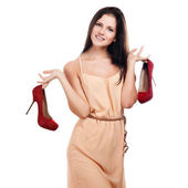 Young woman with red shoes — Stockfoto