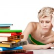 Young student woman with lots of books studying for exams — Stock Photo