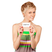 Excited woman showing empty blank paper card sign with copy space for text. — Stock Photo