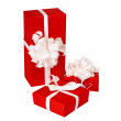 Pillar of boxes with presents wrapped in red paper, isolated on white — Stok Fotoğraf #14211869