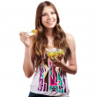 Foto de Stock  : Portrait of girl looking positive and holding bawl with salad