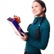 Happy woman with a present — Stock Photo #1638443