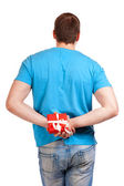 Man with a gift in hand. View from the back. — Stock Photo