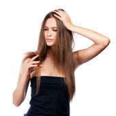 Shocked beautiful brunette girl with creative braid hairdo looking at splitting ends — Foto Stock