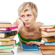 Young student woman with lots of books studying for exams — Foto Stock