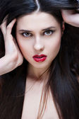 Portrait of sexy brunette with red lips — Stock Photo