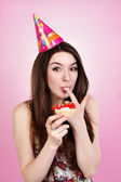 Bautiful caucasian girl blowing candles on her cake — Stock Photo