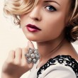 Stock Photo: Portrait of a beautiful girl with a pearl ring