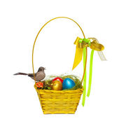 Colorful eggs in a wicker, over white background. — Photo