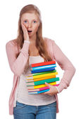 Cute young attractive student girl holding colorful exercise books. — Stock Photo