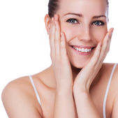 Beautiful face of young adult woman with clean fresh skin - isolated on white — Stock Photo