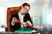 Confident mature business woman sitting on the staircase communicating to someone with — Stock Photo