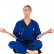 Pretty nurse doing meditation isolated on white — Stock Photo #28680357